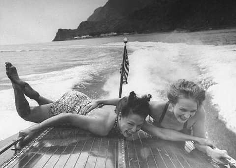 Betty Brooks and Patti McCarty motor boating at Catalina Island.