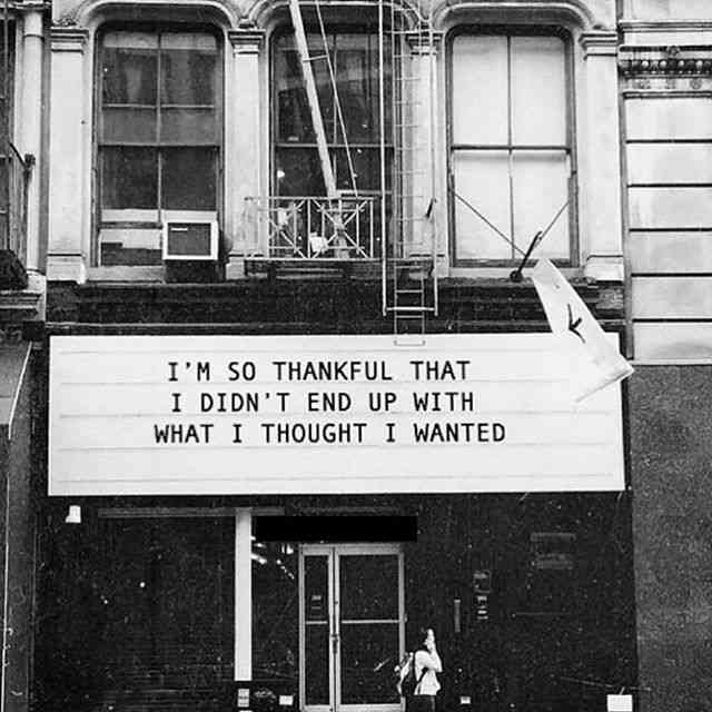 "A photo of a old theatre marquee saying ""I'm so glad I didn't get what I thought I wanted."""
